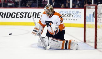 Philadelphia Flyers goalie Michal Neuvirth (30), from the Czech Republic, prepares to make a save during the second period of Game 5 in the first round of the NHL Stanley Cup hockey playoffs against the Washington Capitals, Friday, April 22, 2016, in Washington. (AP Photo/Alex Brandon)