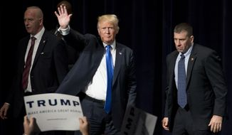 Republican presidential candidate Donald Trump waves to the audience after speaking at a campaign rally in Bridgeport, Conn., Saturday, April 23, 2016. (AP Photo/Michael Dwyer)