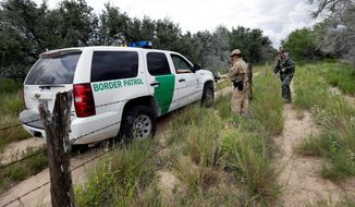 U.S. Customs and Border Protection thought it had a handle on a surge of families and children crossing the border in remote areas of Texas and Arizona, but analysts say new cartels are involved in trafficking. (Associated Press)