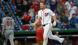The Washington Nationals' Chris Heisey hit his first career walkoff home run in the 16th inning in a 6-5 victor y over the Minnesota Twins on Sunday. (Associated Press)