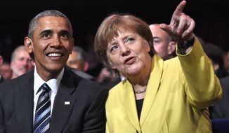 U.S. President Barack Obama, left, and German Chancellor Angela Merkel chat during the opening of the Hannover Messe industry fair in Hannover, northern Germany, Sunday, April 24, 2016. Obama is on a two-day official visit to Germany. (AP Photo/Jens Meyer)