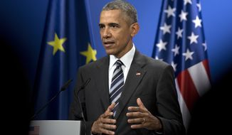 "US President Barack Obama speaks during a joined news conference with German Chancellor Angela Merkel at Schloss Herrenhausen in Hannover, Germany, Sunday, April 24, 2016. President Barack Obama delivered a strong defense of international trade deals Sunday in the face of sharp opposition, both foreign and domestic, declaring that is ""indisputable"" that such pacts strengthen the American and global economies and make U.S. businesses more competitive worldwide. (AP Photo/Carolyn Kaster)"