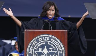 First lady Michelle Obama speaks about her husband, President Barack Obama and the criticism he has withstood during his two terms as she delivers the commencement address for Jackson State University's Class of 2016 at the Mississippi Veterans Memorial Stadium in Jackson, Miss., Saturday, April 23, 2016. (AP Photo/Rogelio V. Solis)