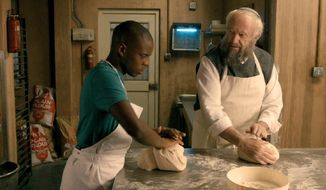 "Jonathan Pryce (right) and Jerome Holder in a scene from ""Dough.""  (Timesfreepress.com)"