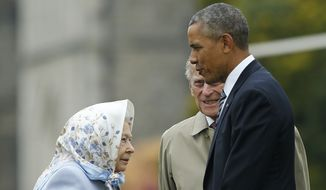 US President Barack Obama, right, talks to Britain's Queen Elizabeth II as he arrives at Windsor castle, England, Friday, April, 22, 2016. Obama and First lady Michelle Obama had a private lunch with Britain's Queen Elizabeth II at Windsor castle. (AP Photo/Alastair Grant, Pool)