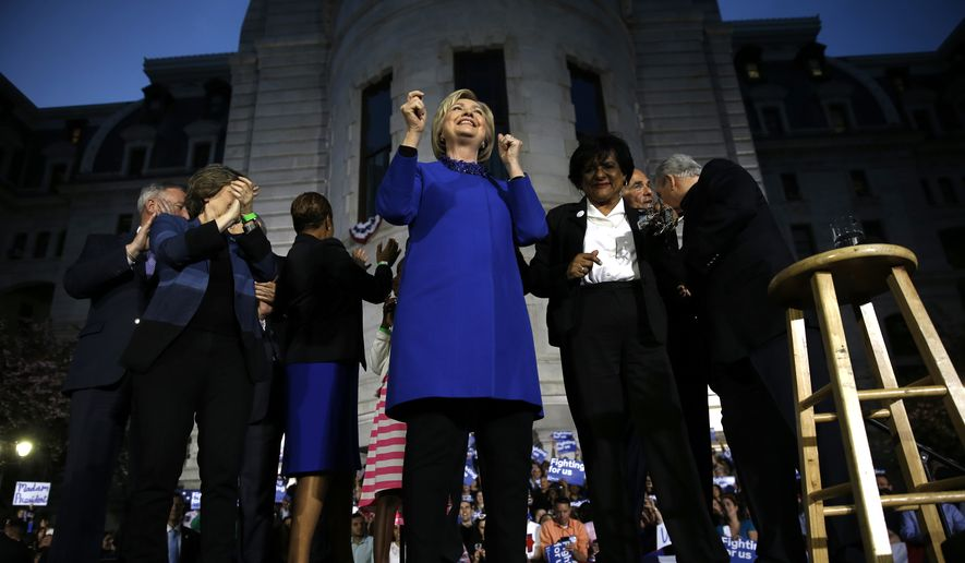 Democratic presidential candidate Hillary Clinton stands with Pennsylvania elected officials during a campaign stop, Monday, April 25, 2016, at City Hall in Philadelphia. (AP Photo/Matt Rourke)