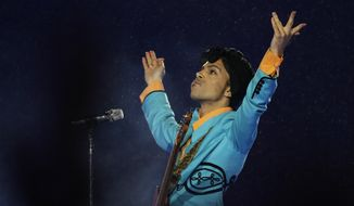 In this Feb. 4, 2007, file photo, Prince performs during the halftime show at Super Bowl XLI at Dolphin Stadium in Miami. (AP Photo/Alex Brandon, File)
