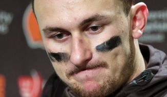 In this Dec. 20, 2015, file photo, Cleveland Browns quarterback Johnny Manziel speaks with media members following the team's 30-13 loss to the Seattle Seahawks in an NFL football game in Seattle.  (AP Photo/Scott Eklund, File)