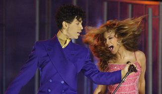In this Feb. 8, 2004, file photo, Beyonce, right, and Prince perform during the 46th Annual Grammy Awards in Los Angeles. In an industry where collaborations with other artists and credits are negotiated as heavily as world treaties, Prince followed only one credo when it came to working with others: the love of the music. Prince died Thursday, April 21, 2016, at his home outside Minneapolis. (AP Photo/Kevork Djansezian, File)