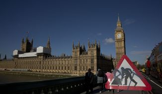 Westminster Bridge, near the Houses of Parliament and Elizabeth Tower, which houses the Big Ben bell in London, Tuesday, April 26, 2016. Officials say the chimes of Britain's Big Ben bell will fall silent for several months during a three-year restoration of Parliament's crumbling clock tower. (AP Photo/Matt Dunham)