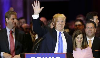 Donald Trump waves to supporters after speaking at a primary night event Tuesday in New York. (Associated Press)