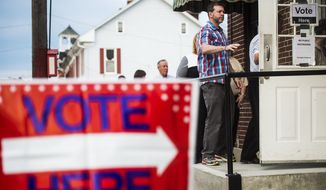 Voters line up to enter at the Hanover Market House polling station in the 2nd Ward Tuesday morning, April 26, 2016, in Hanover, Pa., borough. Pennsylvania voters went to the polls Tuesday with strong views about who should be president. (Shane Dunlap/The Evening Sun via AP)