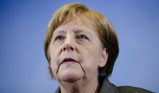 German Chancellor Angela Merkel briefs the media after a visit at Germany's Joint Terrorism Defense Center GATZ (Gemeinsames Terrorismusabwehrzentrum), in Berlin, Tuesday, April 26, 2016. (AP Photo/Markus Schreiber, Pool)