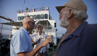 "In this April 24, 2014 photo, film director Bob Yari, left, works with actors Joely Richardson, center, and Adrian Sparks, right, during the filming of the movie ""Papa Hemingway in Cuba"" in Havana bay, Cuba. Though the title derives from the Nobel Prize-winning novelist's nickname, the movie is based on an autobiographical script by Denne Bart Petitclerc, who is played by Giovanni Ribisi, while Hemingway is portrayed by theater and screen veteran Adrian Sparks. (AP Photo/Yesica Fish)"