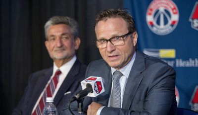 Washington Wizards new head coach Scott Brooks speaks during a news conference at the Verizon Center in Washington, Wednesday, April 27, 2016. Brooks reached a five-year agreement with the team last week. looking on is Wizards majority owner Ted Leonsis. (AP Photo/Pablo Martinez Monsivais)