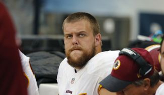 Washington Redskins offensive guard Brandon Scherff (75) watches from the bench during the second half of an NFL football game against the Chicago Bears, Sunday, Dec. 13, 2015, in Chicago. (AP Photo/Charles Rex Arbogast) ** FILE **