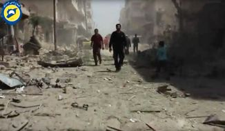 In this Sunday, April 24, 2016, file photo made from video posted online by the Syrian Civil Defense White Helmets, people stand in rubble after airstrikes and shelling hit Aleppo, Syria. (Syrian Civil Defense White Helmets via AP video, File)