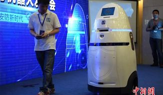 """China has unveiled a first-of-its-kind crimefighting robot that deploys an """"electrically charged riot control tool"""" in the face of security threats. (Twitter/@PDChina)"""