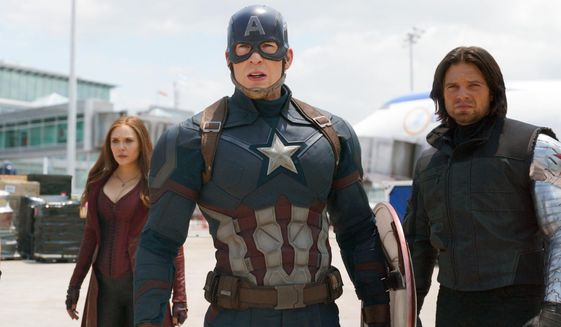 """This image released by Disney shows Elizabeth Olsen, left, Chris Evans and Sebastian Stan in a scene from Marvel's """"Captain America: Civil War,"""" opening in theaters nationwide on May 6, 2016. (Disney/Marvel via AP) ** FILE **"""