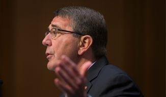 Defense Secretary Ashton Carter, testifying on Capitol Hill, was taken to task over the administration's characterization of anti-Islamic State operations in Syria and Iraq as a noncombat mission.