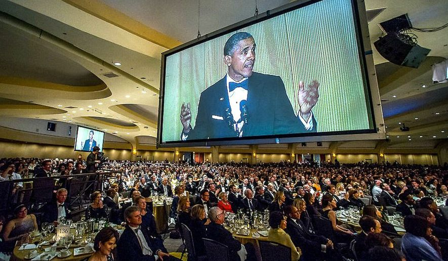 Then-President Barack Obama takes to the dais during the White House Correspondents' dinner. (J.M Eddins for White House Correspondents' Association) ** FILE **