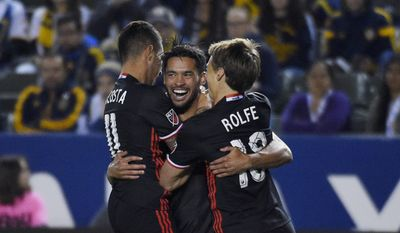 D.C. United midfielder Lamar Neagle, center, celebrates his goal with midfielder Luciano Acosta, left, and forward Chris Rolfe during the first half of an Major League Soccer match against the Los Angeles Galaxy, Sunday, March 6, 2016, in Carson, Calif. (AP Photo/Mark J. Terrill)