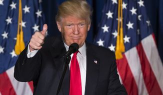 In this Wednesday, April 27, 2016 photo, Republican presidential candidate Donald Trump gives a thumbs up after giving a foreign policy speech at the Mayflower Hotel in Washington. He's become one of the most closely scrutinized people on Earth, but until this week nobody really knew what policies and actions Trump would pursue for the world at large if he elected president. (AP Photo/Evan Vucci, File)
