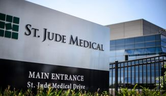 This Wednesday, July 22, 2015, photo shows St. Jude Medical corporate headquarters, in Little Canada, Minn., just north of St. Paul. (Glen Stubbe/Star Tribune via AP)