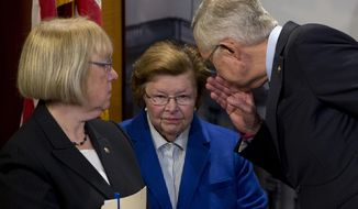 Senate Minority Leader Harry Reid of Nev., right, leans in to speak to Sen. Barbara Mikulski, D-Md., center, as Sen. Patty Murray, D-Wash., stands left, during a news conference on Capitol Hill in Washington, Wednesday, April 27, 2016, to call on congressional Republicans to approve President Barack Obama's emergency supplemental request to fight the Zika virus. (AP Photo/Carolyn Kaster)