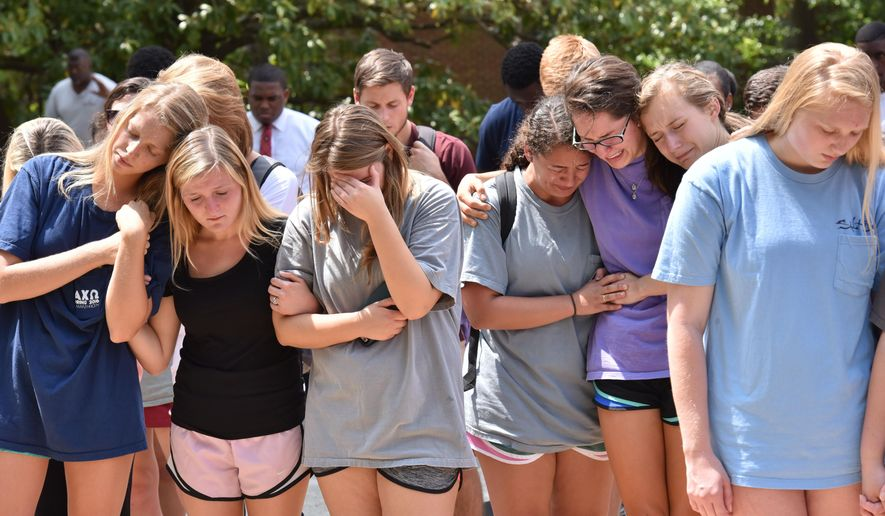 students gather at a memorial for university of georgia students that were killed wednesday in a. Black Bedroom Furniture Sets. Home Design Ideas