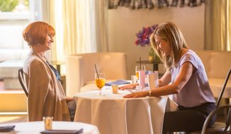 "This image released by Open Road Films shows Julia Roberts, left, and Jennifer Aniston in a scene from ""Mother's Day."" (Ron Batzdorff /Open Road Films via AP)"