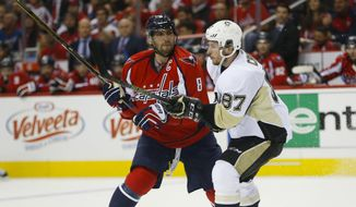 Washington Capitals left wing Alex Ovechkin (8) goes up against Pittsburgh Penguins center Sidney Crosby (87) during the second period of Game 1 in an NHL hockey Stanley Cup Eastern Conference semifinals Thursday, April 28, 2016 in Washington. (AP Photo/Pablo Martinez Monsivais)