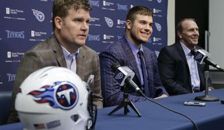 Michigan State offensive tackle Jack Conklin, center, the Tennessee Titans' top draft pick, appears at a news conference with Titans' general manager Jon Robinson, left, and head coach Mike Mularkey, right, on Friday, April 29, 2016, in Nashville, Tenn. (AP Photo/Mark Humphrey)
