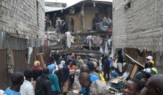 People help survivors retrieve their household items at the site of a building collapse in Nairobi, Kenya, Saturday, April 30, 2016. A six-story residential building in a low income area of the Kenyan capital collapsed Friday night under heavy rain and flooding, killing at least seven people and injuring over 100 others, Kenyan officials said. (AP Photo/Sayyid Abdul Azim)