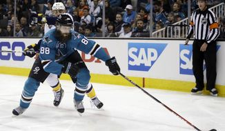 San Jose Sharks' Brent Burns (88) reaches for the puck in front Nashville Predators' Mike Ribeiro during the second period of Game 1 in an NHL hockey Stanley Cup Western Conference semifinal series Friday, April 29, 2016, in San Jose, Calif. (AP Photo/Marcio Jose Sanchez)