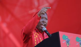 Economic Freedom Fighters (EFF) party leader, Julius Malema, addresses supporters at the launch of their municipal election manifesto in Soweto, Saturday, April 30, 2016. Fiery South African opposition politician Malema told 40,000 cheering supporters that President Jacob Zuma should step down before the army turns on him because of the corruption allegations against him. (AP Photo/Denis Farrell)