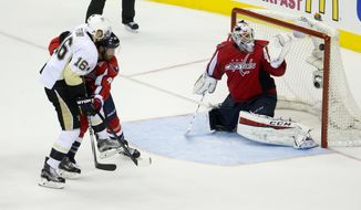 Pittsburgh Penguins right wing Eric Fehr (16) watches his shot go past Washington Capitals goalie Braden Holtby (70) for the tie-breaking goal, as Brooks Orpik defends during the third period of Game 2 in an NHL hockey Stanley Cup Eastern Conference semifinals Saturday, April 30, 2016 in Washington. Pittsburgh won 2-1. (AP Photo/Pablo Martinez Monsivais)
