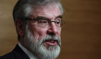 Gerry Adams, the longtime leader of Irish Republican Army's political wing, used the most toxic of all racial slurs Sunday night. (Associated Press)