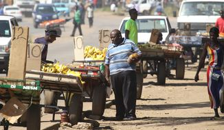 Vendors selling fruit from their push carts on the streets of Harare, Sunday, May 1, 2016, as Zimbabwe joined the rest of the world in commemorating International Workers Day, which is held annually to recognise the economic and social achievements of workers globally. According the African Development Bank statistics, over two thirds of the country's population are employed in the 'informal' sector.(AP Photo/Tsvangirayi Mukwazhi)