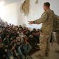 Marine Reserve Maj. Jason Brezler speaks with children attending school at the district center in Now Zad, Afghanistan, on Dec. 15, 2009. (1st Marine Division Public Affairs)