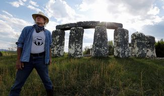"""Mark Cline stands before """"Foamhenge,"""" his full-sized foam and fiberglass recreation of Stonehendge, located on Rt. 11 near Natural Bridge, Virginia. Mr. Cline must move the monument before Aug. 1 because Foamhenge sits on property that will become part of the new Natural Bridge State Park. (Associated Press)"""