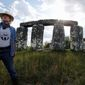 "Mark Cline stands before ""Foamhenge,"" his full-sized foam and fiberglass recreation of Stonehendge, located on Rt. 11 near Natural Bridge, Virginia. Mr. Cline must move the monument before Aug. 1 because Foamhenge sits on property that will become part of the new Natural Bridge State Park. (Associated Press)"
