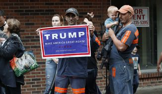 Coal miner Chris Steele showed support for Republican presidential candidate Donald Trump outside a campaign event in May for Democratic nominee Hillary Clinton in Williamson, West Virginia. (Associated Press)