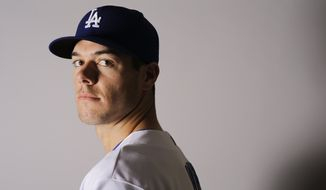 This Saturday, Feb. 27, 2016 photo shows Josh Ravin of the Los Angeles Dodgers baseball team. Ravin has been suspended for 80 games following a positive test under Major League Baseball's drug program. He tested positive for Growth Hormone Releasing Peptide 2 (GHRP-2), the commissioner's office said Monday, May 2. (AP Photo/Chris Carlson)