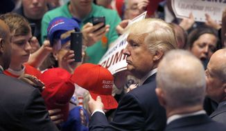 Republican presidential candidate  Donald Trump looks at the line of supporters as he works the crowd after a campaign stop Monday, May 2, 2016, in South Bend, Ind. (AP Photo/Charles Rex Arbogast)