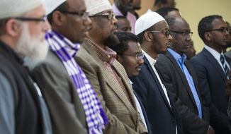 Muslim leaders gather for a news conference at the Abubakar Islamic Center in Minneapolis, Monday, May 2, 2016. A senior Transportation Security Administration manager at the Minneapolis-St. Paul International Airport has testified that he received pressure to profile Somali imams and community members visiting his office. (Leila Navidi/The Star Tribune via AP)