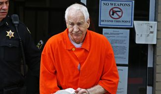 Former Penn State University assistant football coach Jerry Sandusky leaves the Centre County Courthouse after a hearing of arguments on his request for an evidentiary hearing as he seeks a new trial in Bellefonte, Pa., Monday, May 2, 2016. (AP Photo/Gene J. Puskar)