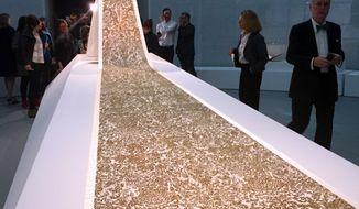 """A wedding gown train by Karl Lagerfeld for Chanel's 2015 Patrimoine Collection is displayed as part of the """"Manus x Machina: Fashion in the Age of Technology,"""" exhibit at the Metropolitan Museum of Art in New York on Monday, May 2, 2016. The exhibit opens May 5 and runs through Aug. 14. (AP Photo/Jocelyn Noveck)"""