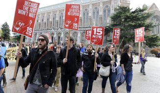 FILE - In this April 1, 2015, file photo, students and other supporters protest on the University of Washington campus in Seattle, in support of raising the minimum wage for campus workers to $15 an hour. The U.S. Supreme Court said Monday, May 2, 2016, they will not hear a challenge to Seattle's $15-an-hour minimum wage from franchise owners who say the law discriminates against them by treating them as large businesses. (AP Photo/Ted S. Warren, File)