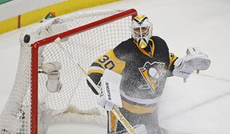 Pittsburgh Penguins goalie Matt Murray (30) deflects a puck over the net during the first period of Game 3 against the Washington Capitals in an NHL hockey Stanley Cup Eastern Conference semifinals in Pittsburgh, Monday, May 2, 2016. (AP Photo/Gene J. Puskar)